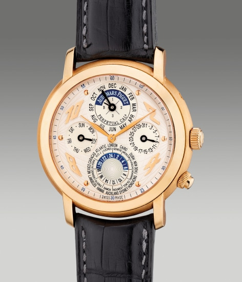 A fine pink gold perpetual calendar world time wristwatch with 24-hour and leap year indication