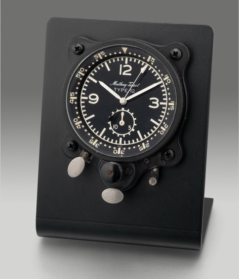 An attractive blackened metal case mechanical aircraft clock with flyback chronograph set within a metal frame