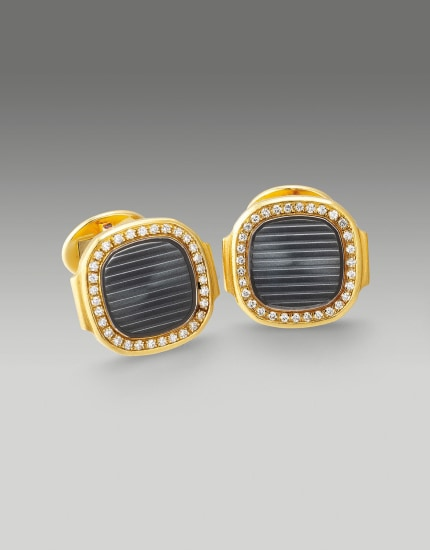 An exquisite pair of yellow gold, sapphire crystal and diamond-set cufflinks