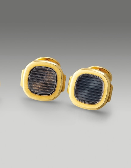 An exquisite pair of yellow gold and sapphire crystal cufflinks