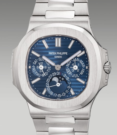 A rare and attractive white gold perpetual calendar wristwatch with 24-hour indication, leap year, moon phases, Certificate of Origin and presentation box