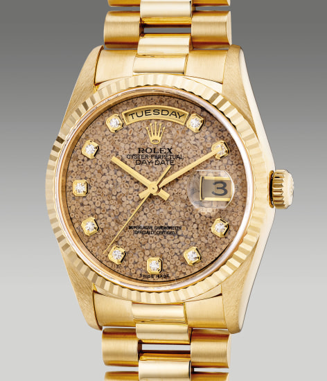 """A fine and attractive yellow gold wristwatch with center seconds, day, date, """"Jurassic"""" fossil dial, diamond-set indexes, bracelet, guarantee and box"""