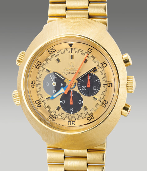 A very rare and attractive oversized yellow gold tonneau-shaped pilot's chronograph wristwatch with dual time, 24-Hour indication and bracelet