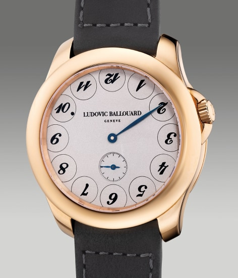 """A fine and attractive pink gold wristwatch with unusual """"upside down"""" dial, guarantee and box"""