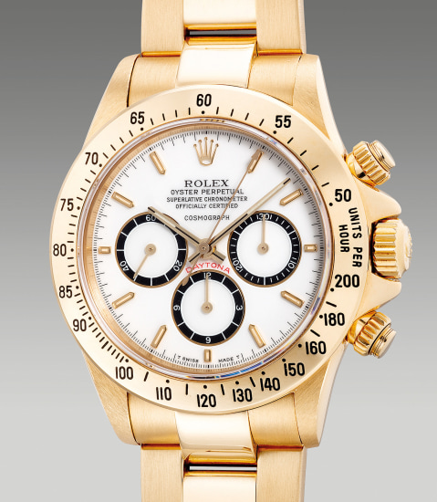 """An extremely rare and highly attractive yellow gold chronograph wristwatch with """"Floating Cosmograph"""" white porcelain dial and bracelet"""