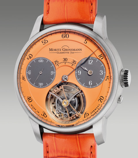 A unique and attractive three-minutes flying tourbillon regulator wristwatch with stop seconds, orange dial, warranty card and presentation box