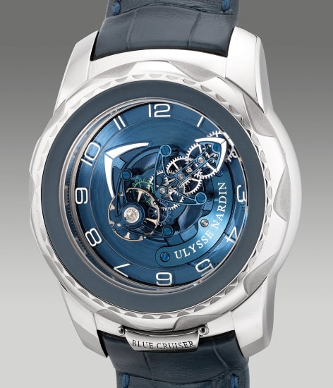 A fine and unusual white gold wristwatch with carrousel tourbillon, dual direct escapement, warranty and box