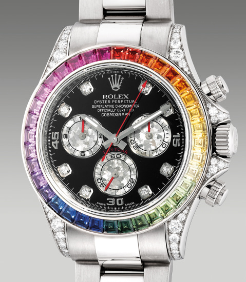 An extremely rare and attractive white gold, diamond and rainbow-colored sapphire-set chronograph wristwatch with bracelet, guarantee and box