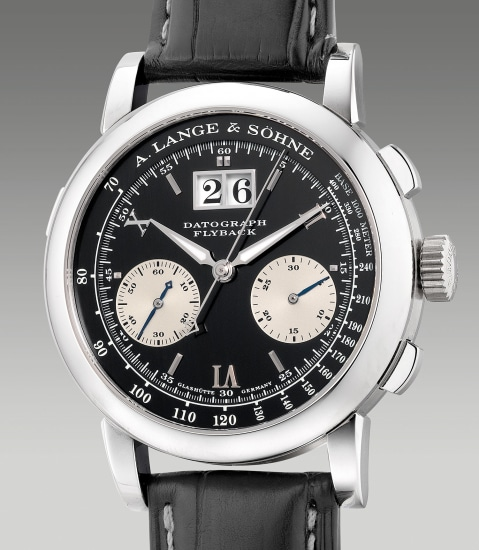 A very fine and attractive platinum flyback chronograph wristwatch with large date, tachymeter scale, guarantee and box