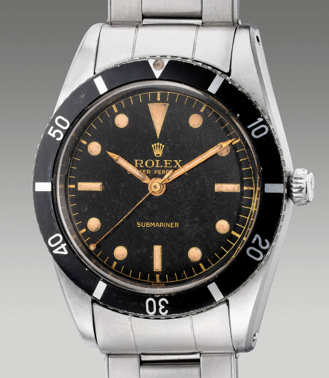 "A very fine, early and well-preserved stainless steel diver's wristwatch with center seconds, ""gilt"" dial and bracelet"