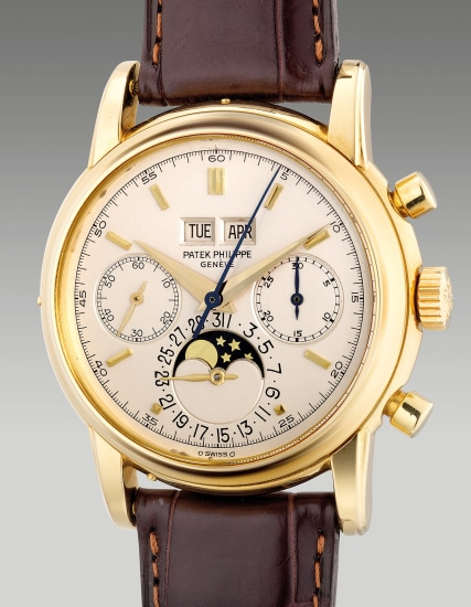 An extremely fine and rare yellow gold perpetual calendar chronograph wristwatch with moon phases