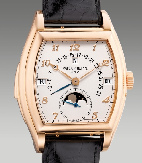 An extremely fine and impressive pink gold tonneau-shaped minute repeating perpetual calendar wristwatch with moon phases, retrograde date, leap year indication and Breguet numerals