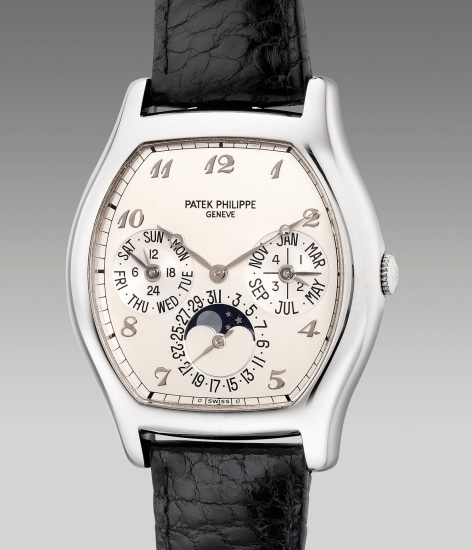 A fine and attractive white gold tonneau-shaped perpetual calendar wristwatch with moon phases, leap year indication, Breguet numerals, Certificate of Origin and presentation box