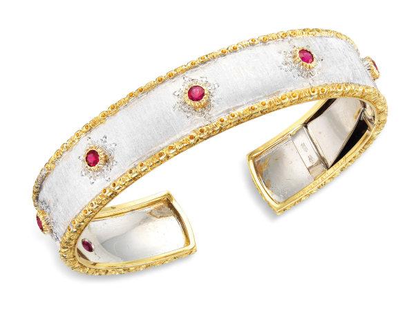 A Two-tone 18 Karat Gold and Ruby Cuff Bangle