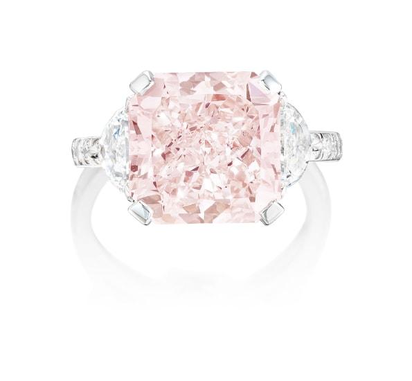 A Fancy Light Orangy Pink Diamond and Diamond Ring