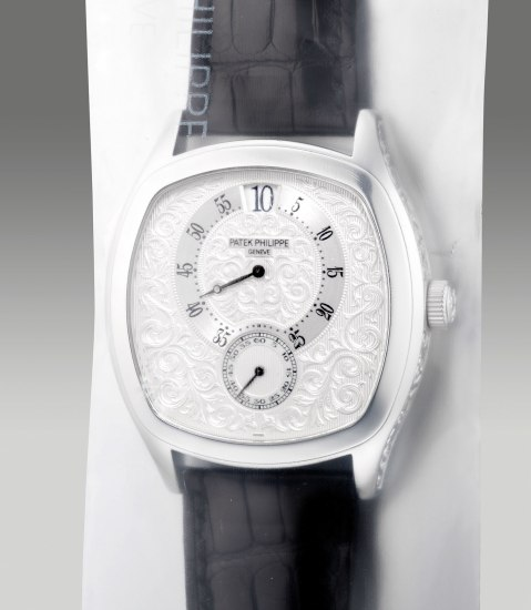 An exceptional and rare limited edition platinum chiming wristwatch with jump seconds and minutes, digital jump hour, engraved dial and case, with Certificate of Origin, made for the 175th anniversary of Patek Philippe, single sealed