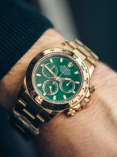 Rolex - Ref 116508 Yellow Gold Green Daytona with box, guarantee card and hang tags, 2018 | Phillips