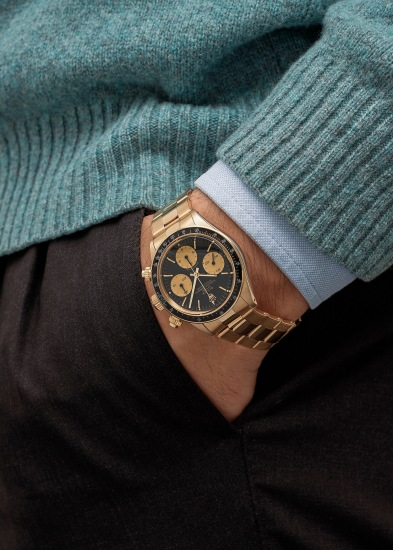 A rare and attractive 14K yellow gold chronograph wristwatch with black dial and 18K yellow gold bracelet